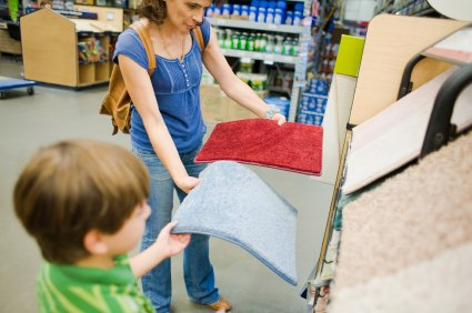 Mother and son shopping for carpet