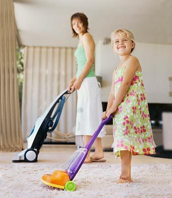 Mom and Daughter Vacuuming